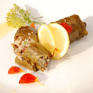 dolmades with tagetes petals, dill flowers and fresh herbs