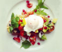 poached egg with edible flowers